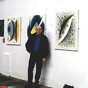 The artist with his work on display
