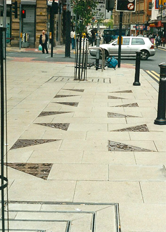 Metal castings in pavement